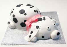 Dalmatian dog cake with pink bow