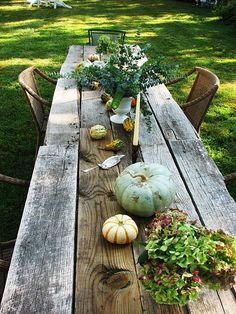 We could make a rustic table like this someday when we either replace the boards on the barn or tear down the old garage!