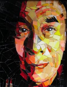 Mosaic art panels featuring faces made of scraps of stained glass.