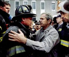 On September 14, 2001, in New York United States, President George Bush comforts New York City Fire Dept Lt Lenard Phelan of Battalion 46, whose brother, Lt Kenneth Phelan of Battalion 32, is among the 300 members of the FDNY still unaccounted for from the terrorist attacks at the World Trade Center. (Photo by 8393/Gamma-Rapho via Getty Images)
