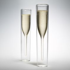 An ideal special-occasion gift, Inside Out Champagne Glasses have simple water glass-shaped exteriors, but reveal the iconic champagne-glass silhouette when filled. The glasses are made of durable mouth-blown clear borosilicate glass, which has an insulating effect.