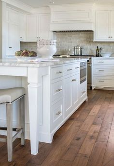 White Kitchen Wood Floor kitchen. kitchen with white cabinets and wide hardwood plank