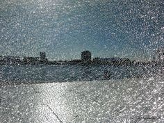A view of Amsterdam as seen through a broken window along the stairs of the new Eye Film Institute Netherlands.