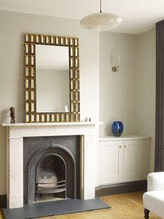 alcove shelves beside a fireplace