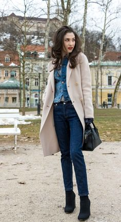 Fashion Blogger Veronika Lipar of Brunette from Wall Street wearing chic casual denim on denim trend, blue cropped denim jacket from H&M, with tapered straight-leg dark blue denim jeans from A.P.C., pastel pink, off-white double breasted Weekend Maxmara coat, black top handle bag, blue leather gloves and black sock ankle boots from Elena Iachi at the end of winter
