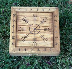 "This hand-burned Norse Protection Box is great for storing runes and other trinkets of the faith.  The centerpiece is the Helm of Awe and is a known symbol of protection and is framed by the Elder Futhark Runic alphabet.  A great gift for those of the Asatru faith or anyone following the Norse pantheon.  Stained and sealed for protection, it measures 5 3/4"" x 5 3/4"" x 2"". Also would make a GREAT TRAVEL ALTAR"