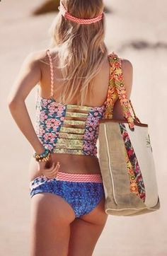 Love the print's and colours in this pic, if only the bikini bottoms could magically turn into a maxi skirt. LOL