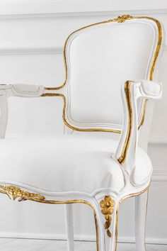 The hand crafted Louis XV style Regent Side Chair features delicate floral carvings, a hand applied white finish, gilded accents, and white upholstery.   Ave Home