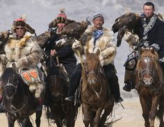 hunting with eagles in mongolia - there are too many things I love about this photo to mention.