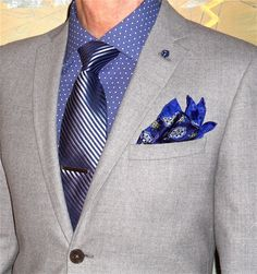 Hilton grey flannel suit, Perry Ellis shirt, Burma Bibas tie…