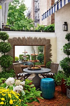 Garden Patio - Bijou interiors with a sense of spaciousness that belies exterior appearance - real homes on HOUSE by House & Garden.