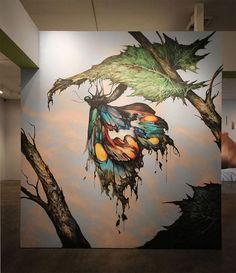 street artists paint museum walls