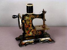 Sewing Toys I LOVE the look of this embellished vintage machine. It's for sure that gramma never used a machine like this, but in terms of color and tone, the embelishment is KINDA true to those of the era. Sewing Machines Best, Antique Sewing Machines, Vintage Sewing Notions, Vintage Sewing Patterns, Sewing Toys, Sewing Crafts, Antique Toys, Vintage Antiques, Sewing Stuffed Animals