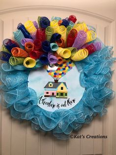 This adorable wreath was designed for a wedding themed around Disney's Up! Contact me for. Custom design
