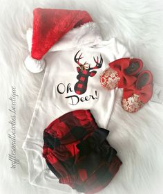 Your baby girl's wardrobe is incomplete without Christmas Onesie's! Our Oh Deer body suit has an adorable deer design on it. And the best part is that the deer is wearing a bow! Pair this onesie with