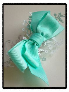 Turquoise aqua bow ship clip.  Love this color!!!