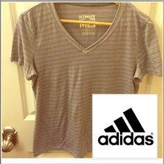 Adidas Women's ultimate Tee Size M Adidas ultimate women's tee. V-Neck, size medium, gray and light gray stripes, polyester blend. No flaws, stains, or trades- offers are ok. Adidas Tops Tees - Short Sleeve