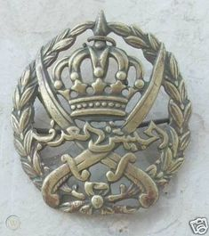 Badge of the Arab Legion (al-Jaysh al-ʿArabī lit. the Arab Army), the regular army of Transjordan formed in 1920 by British captain Peake. During World War II WWII, the Arab Legion took part in the British war effort against pro-Axis forces. Curved Swords, Mounted Archery, Ottoman Turks, Types Of Swords, Horsemen Of The Apocalypse, Sword Design, National Flag, North Africa, Wwii