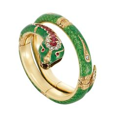 Antique Gold, Green Enamel, Ruby and Diamond Snake Bangle Bracelet  The bracelet engraved with detailed stylized scales applied with apple green enamel, spaced by gold bands engraved with a leaf motif and five engraved panels centering a rose-cut diamond, terminating in a snake head topped with 8 oval and cushion-shaped rubies and 11 rose-cut diamonds, tipped by a diamond-set gold tail
