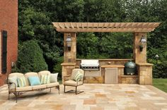Pergola nicely frames this outdoor cooking area with built-in grill and Big Green Egg.