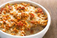 Bruschetta Chicken Bake      1    can (14-1/2 oz.) diced tomatoes, undrained      1    pkg. (6 oz.) STOVE TOP Stuffing Mix for Chicken      1/2    cup water      2    cloves garlic, minced      1-1/2    lb. boneless skinless chicken breasts, cut into bite-size pieces      1    tsp. dried basil leaves      1    cup KRAFT 2% Milk Shredded Mozzarella Cheese