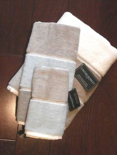 Cynthia Rowley Bath Collection wide horizontal striped 100% cotton terry towels with border in-between each stripe, 3 piece set, Bath towel, hand towel and finger tip face towel.  Very soft, fluffy, high quality towels in subtle shades of cream, gray, taupe, and blue. You can design your bathroom around these colors. Tres chic!