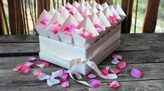 The white cardstock cones are lovely for all occasions... we are currently filling them with kisses for Valentine's Day... a box of 24 is perfect for a classroom full of kids...
