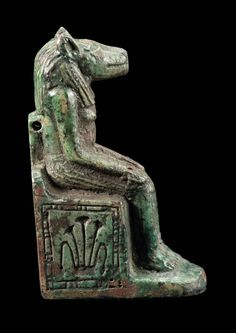 Green-glazed faience amulet of enthroned Anubis. Side view. Late Period. 760–343 B.C. | Museum of Fine Arts, Boston