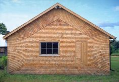 A two dimensional tromp-l'oeil, crafted from cedar shingles on the end wall of a… Cedar Shingle Siding, Cedar Shake Siding, Cedar Shingles, Wood Siding, Exterior Siding, House With Porch, Picture On Wood, Cladding, Woodworking