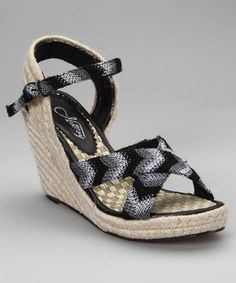 More than just stylish, these charming espadrilles also provide a flattering lift. A trendy chevron pattern dresses the upper, while a high wedge heel ensures a sturdy wobble-free strut.