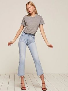 89209d0685b8 Pair mid cropped flare jeans with a simple tucked in tee and sandals. Let  Daily