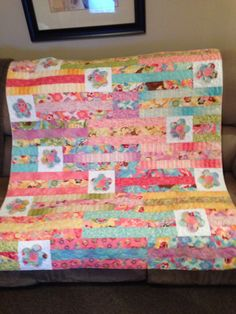 Jelly roll quilt with flowers
