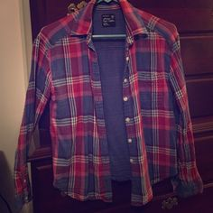 Plaid button down Plaid button down from AE. Perfect condition. Purple pink and some blue. Boyfriend fit. American Eagle Outfitters Tops Button Down Shirts