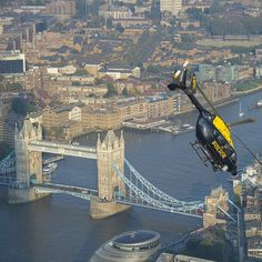 Looking for a new #wallpaper for your #computer How's about another two #London #icons #metpolice #helicopter and #towerbridge #thames #river #boris #avgeek #flying #picoftheday #photography #instalike #instafollow #city