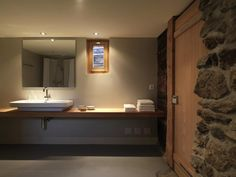 Rustic Alpine house in Switzerland with a modern bathroom addition. Alpine House, Alpine Chalet, Swiss Chalet, Bathroom Design Inspiration, Weekend House, Wooden Staircases, Mansions Homes, Architectural Features, Modern Interior Design