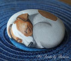 This is a One-of-a-kind hand painted rock featuring a Jack Russell Terrier curled up in a ball sleeping on a pillow. Perfect for the dog lover that is looking for a unique piece of art! This stone measures approximately 6 wide by 4 high and weighs approximately 5 pounds. Would make a cute door stop or looks great sitting on a shelf, near a plant, etc. Safe for outdoor use. Painted with several layers of acrylic paint and indoor/outdoor varnish.  I find most of my stones while walking on ...