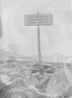 "Sign on the top of Flat Top Mountain reads: ""Flat Top Trail/ Estes Park 13 M./ Grand Lake 17 M."" Part of a series of pictures taken while hiking in the Long's Peak area of north central Colorado. Dates[ between 1910 and 1920 ] :: Photograph Collection"
