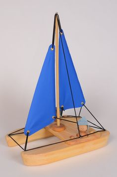 Blue Catamaran wooden bathing toy by by LAtelierChevaldeBois