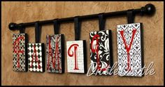 shoe box lids, scrapbook paper, mod podge, letters, ribbon, and a curtain rod.