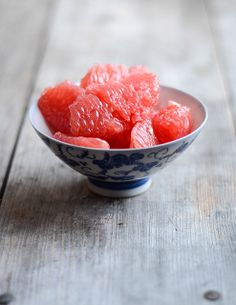 a bowl of pink grapefruit, ready to be devoured