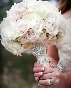 A simple bouquet of white & blush roses becomes a focal point when you add crystals and pearls. Photo by @darinfongphotography