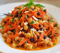 Moroccan Carrot & Chickpea Salad- TESTED & PERFECTED RECIPE- With fragrant spices, bright colors & savory flavors, this exotic twist on the carrot-raisin salad is a feast for the senses. Carrot Recipes, Healthy Recipes, Healthy Salads, Delicious Recipes, Moroccan Carrots, Moroccan Chicken, Moroccan Salad, Moroccan Chickpea Salad, Moroccan Style