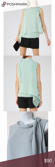 {Reiss} Tie Neck Top Imagined in a gem-green hue and cut from a lightweight fabric, this top will be a staple piece in your closet! Together, the loose chiffon overlay and the neck-tie work to give this piece an ethereal feel. Wear it with everything from sharp tailoring to shite denim. Wide roll neck. Side neck-tie detailing. Loose fit. Side zip fastening. Reiss Tops