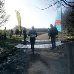 Crossing the finish line at the Longman 10k 2014