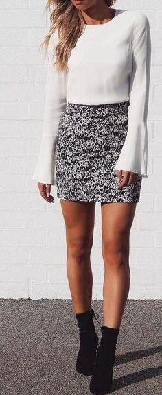 #spring #outfits White Top + Black Printed Skirt + Black Booties