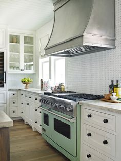 I love the colored stove and the huge, steel vent hood.  Its a great mixture of industrial and traditional.