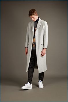 Matthew Miller pale grey wool overcoat, Head of Goliath Carvaggio t-shirt, and black wool trousers with Nike sneakers.