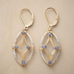 """WRAPPED HOOP EARRINGS--Dana Kellin wraps sterling silver hoops with 14kt gold filled wire, incorporating the beauty of blue tanzanite into her design. Lever back wires. Handmade in USA. 1-3/4""""L."""