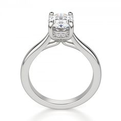 With the classic look of a solitaire from above, the Verona engagement ring has more intricacy than initially meets the eye. The setting of the Contemporary Nexus Diamond™ is lined with glimmering accents, creating a delicate look from every angle.  Center stone pictured: 1.46 carat Oval cut  Center stone is available in a variety of carat weights; choose yours from the menu above. Complete the look with the Manhattan band. Order additional services like a personal engraving or an appraisal…