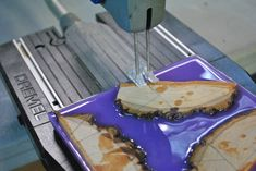 wood cuts in lavender resin being cut my dremel moto saw